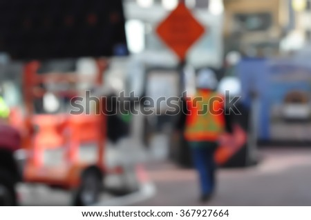 Construction worker walking on building site - stock photo