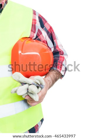 Construction worker wearing protective vest and holding safety gloves and hard hat isolated on white background