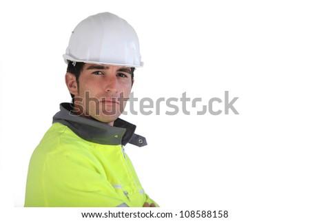 Construction worker wearing reflective jacket - stock photo