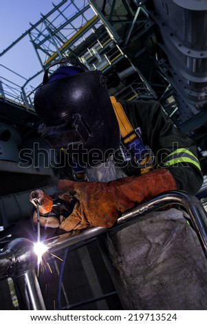 Construction worker welding a piece of steel