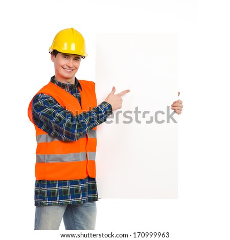 Construction worker with a banner. Three quarter length studio shot isolated on white.