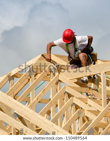 Construction worker with a hammer - stock photo