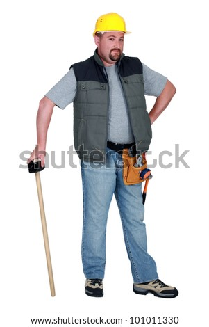 Construction worker with a sledgehammer - stock photo