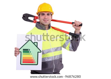 Construction worker with an energy certificate - stock photo