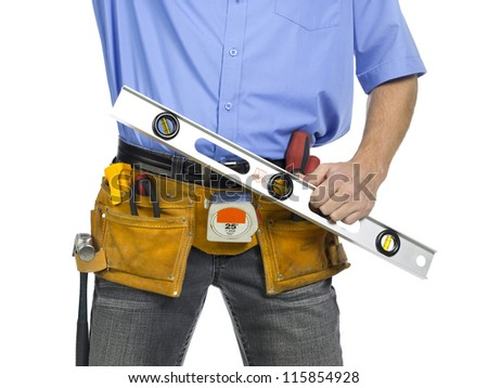 Construction worker with belt and holding a level ruler - stock photo