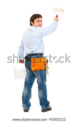 Construction worker with bucket and brush painting - stock photo