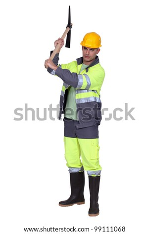 Construction worker with pick-axe