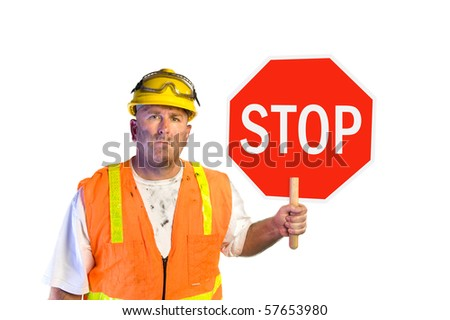 Construction worker with stop sign isolated on white - stock photo