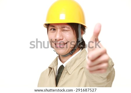 construction worker with thumbs up gesture