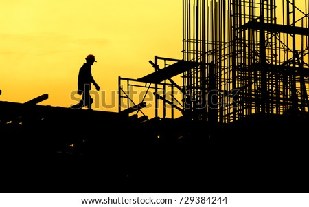 Construction worker working on a construction site,for construction teams to work in heavy industry, high ground and safety concepts.