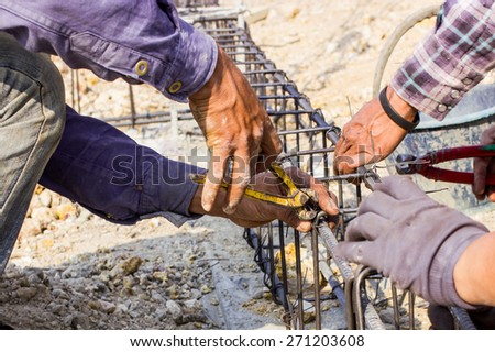 construction workers are steel tie - stock photo