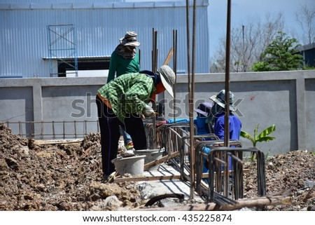 construction workers are working install reinforcement steel bar for ground beam reinforced concrete in construction site - stock photo