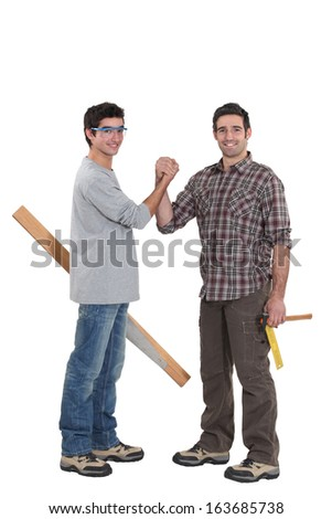Construction workers collaborating - stock photo