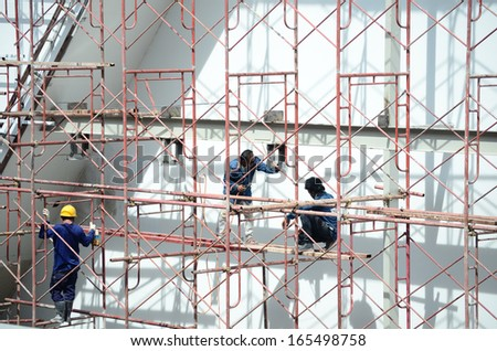 construction workers in scaffold - stock photo