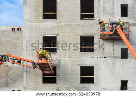 Construction workers on a scaffolding