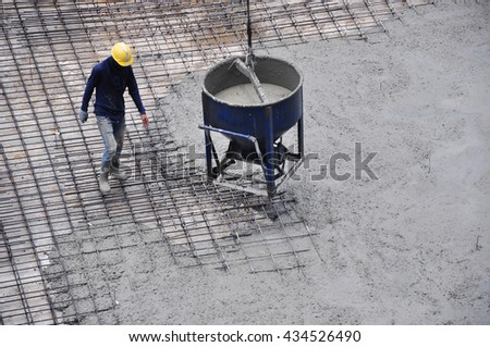 Construction workers pouring concrete on top slab ground floor plan at the construction site. - stock photo