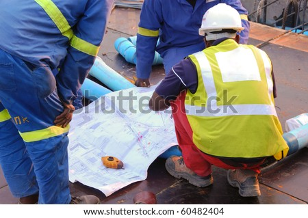 Construction workers reading a drawing