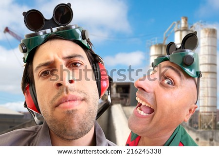 Construction workers team making funny faces isolated in white