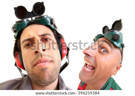 Construction workers team making funny faces isolated in white - stock photo