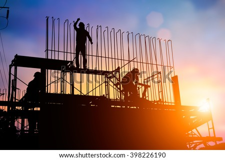 Construction workers work in preparation for binding rebar and concrete work. and the environment around the work site. over Blurred construction worker on construction site - stock photo