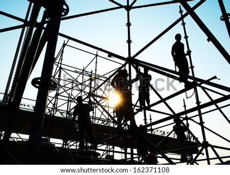 Construction workers working on scaffolding