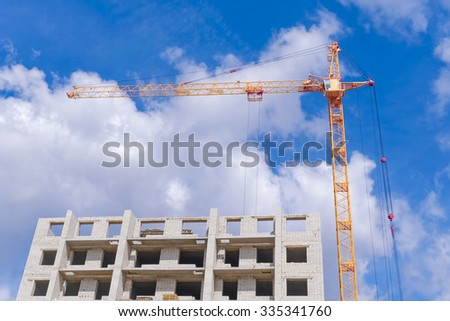 Construction works and highrise houses - stock photo