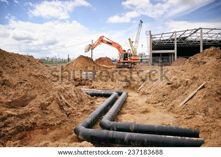 Construction works, construction machinery, bulldozer, excavation, factory - stock photo