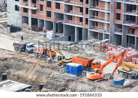Constructional machinery on construction site, aerial view - stock photo
