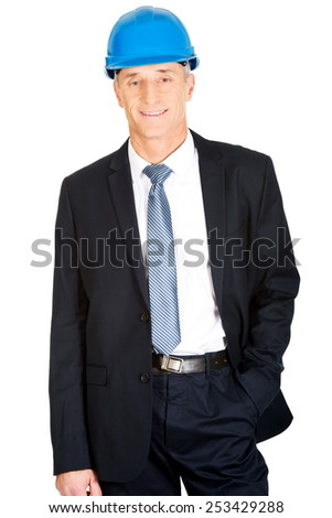 Constructor businessman with hand in pocket.