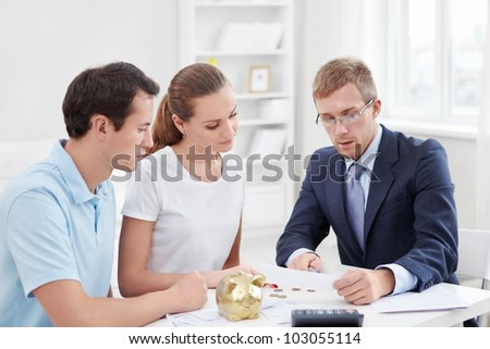 Consultant and a young couple at home - stock photo