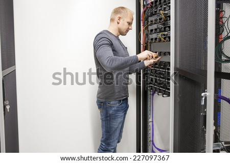 Consultant builds communication rack in datacenter