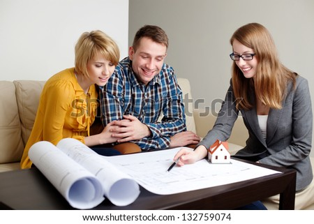 Consultant explaining home project. - stock photo
