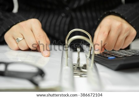 consultant is searching for irregularities in the documentation - stock photo