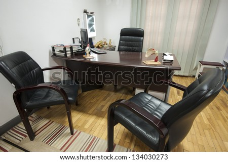 Consultation room in a doctors surgery with desk and chairs