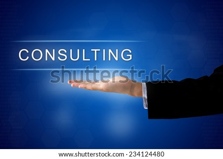 consulting button with business hand on a touch screen interface - stock photo