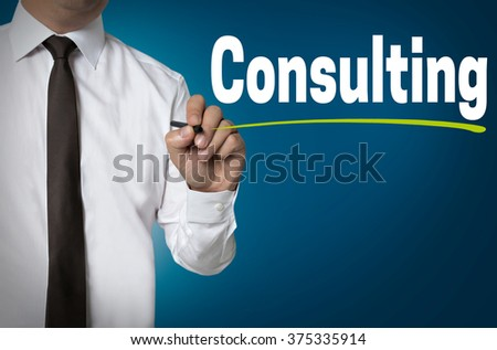 Consulting is written by businessman background concept. - stock photo