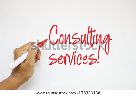 Consulting Services! sign on whiteboard - stock photo