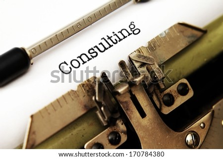 Consulting text on typewriter - stock photo