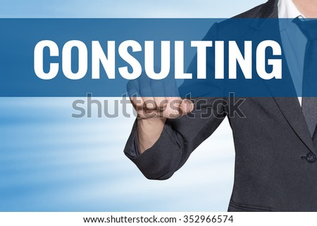Consulting word Business man touching on blue virtual screen - stock photo