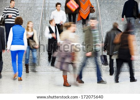 Consumer Walking Up Stairs, Motion Blur - stock photo
