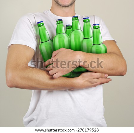 consumer with a lot of bottles of beer in their hands