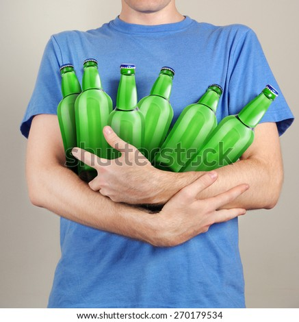 consumer with a lot of bottles of beer in their hands - stock photo