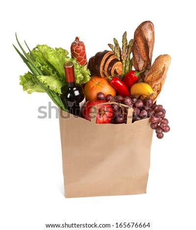 Consumers bag / studio photography of brown grocery bag with fruits, vegetables, bread, bottled beverages - isolated over white background