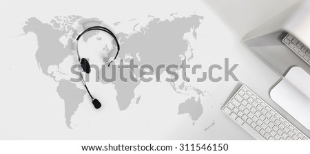 contact global concept , top view desk with headset, computer and map - stock photo