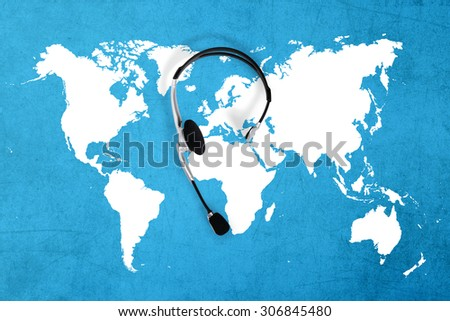 contact global concept , top view headset and map - stock photo