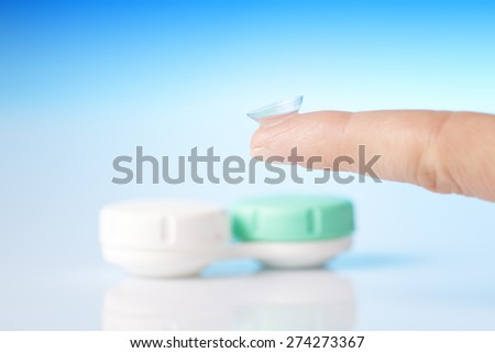 contact lens on finger and case