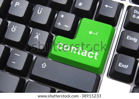 contact text written on a computer keyboard