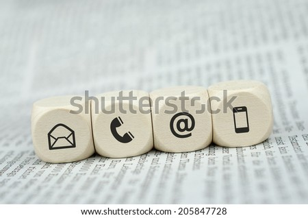 Contact Us Cubes on Newspaper  - stock photo