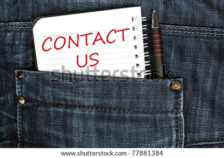 Contact us message on notepad - stock photo