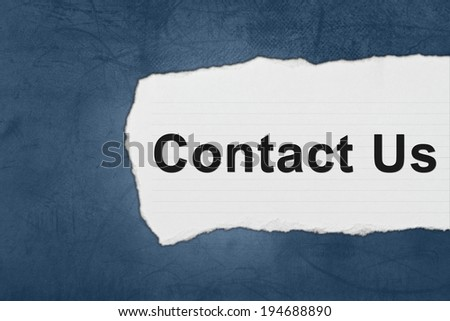 Contact us with white paper tears on blue texture - stock photo